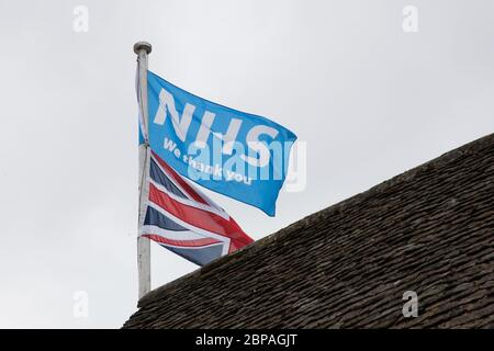 A flag flying in support of the NHS during the Covid 19 outbreak in Burford in the UK in 2020 - Stock Photo