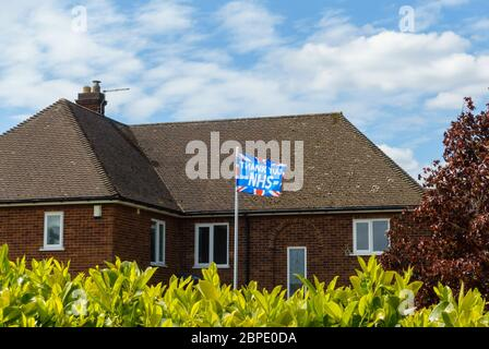 'Thank You NHS' union flag flying on flagpole in front of house to say thanks to NHS during the coronavirus pandemic, May 2020, England, UK - Stock Photo