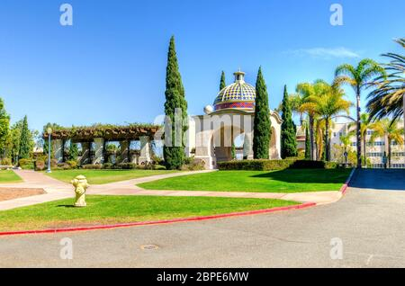 A view of the arched colorful mosaic architecture and palm trees in the Balboa Park in San Diego, California in the United States of America. A beauti - Stock Photo