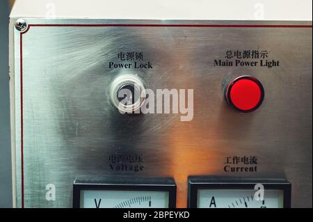 Control panel in main engine room. inscriptions in English and Chinese - Stock Photo