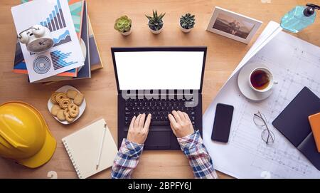 work from home. designer, engineer typing on computer keyboard working via laptop with blank screen for copy space during home isolation