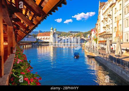 Kapellbrucke historic wooden bridge in Luzern and waterfront landmarks dawn view, town in central Switzerland