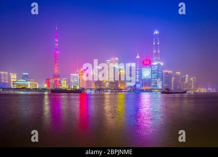 Shanghai by the Huangpu River on a foggy night, China city skyline