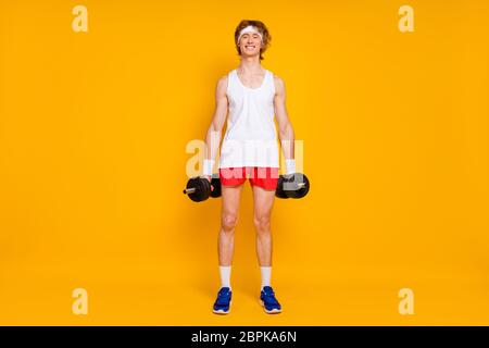 Full length body size view of his he nice attractive cheerful cheery slim thin guy sportsman doing work out holding in hand barbell isolated over - Stock Photo
