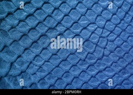 Texture of genuine leather embossed under skin a reptile. Natural backdrop, copy space. Concept of shopping, manufacturing
