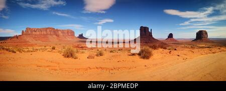Monument Valley panoramic view over the Colorado Plateau within the Navajo Nation Reservation with the popular buttes and Sentinel Mesa