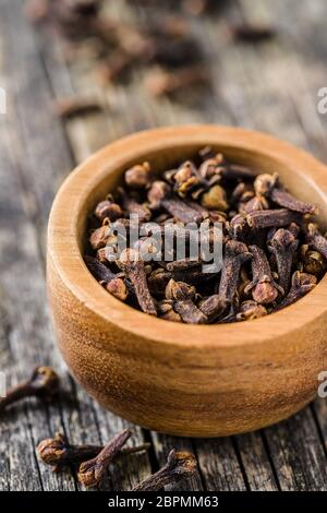 Carnation, dried clove spice in bowl.