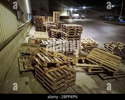 Pallet racks inside a cement plant. Loading shop of a cement plant.