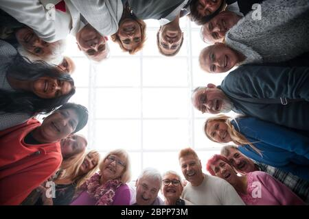 Happy people looking down at camera