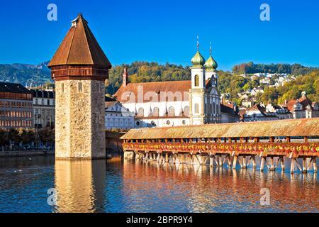 Kapellbrucke historic wooden bridge in Luzern and waterfront landmarks view, town in central Switzerland