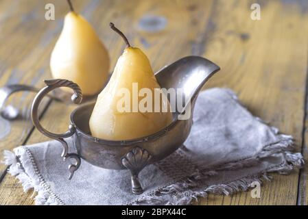 Poached pears in the gravy boat - Stock Photo