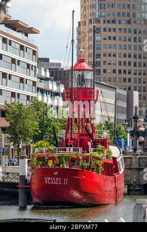 Rotterdam, The Netherlands, May 17, 2020:former light vessel, now a restaurant and bar, at its mooring place in Wijnhaven harbour - Stock Photo