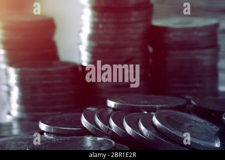 Close up of coins to stack of coins, Business Growth concept, There is money coins to stack of coins. Financial risk.