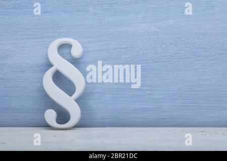Close-up Of A Paragraph Symbol Leaning On Blue Wall