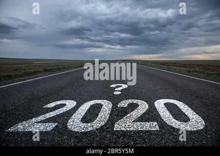 Desert road with the text 2020 and a question mark. - Stock Photo