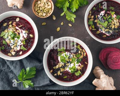 Ideas and recipes for healthy soup - Beetroot and ginger soup puree. Clean eating, detox, vegetarian diet concept. Top view of plate with perfect beet - Stock Photo