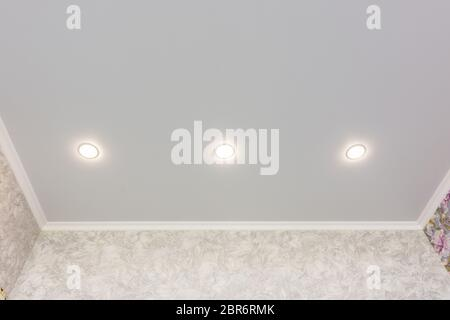 Three spotlights built into the suspended ceiling