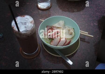 Egg noodle with red roast pork , Thai food Lunch menu set - Stock Photo