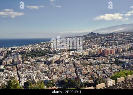 View of the capital Santa Cruz de Tenerife from the Mirador de los Campitos in the evening sun and blue sky.