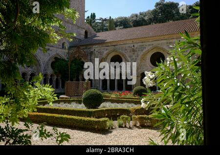 Cloister and garden of Abbaye Sainte-Marie de Fontfroide or Fontfroide Abbey near Narbonne, Aude department, Occitanie, France, - Stock Photo