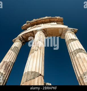 Athena Pronaia Temple in the archaeological site of Delphi, seat of the oracle of the god Apollo - Stock Photo