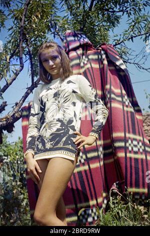 young slim pretty female posing in garden wearing fashionable mini dress 1970s hungary