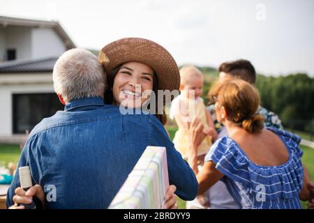 Portrait of happy people outdoors on family birthday party.