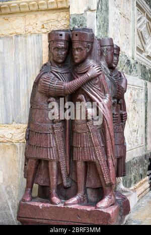 The ancient Portrait of the Four Tetrarchs by the St Mark`s Square in Venice, Italy. It is a porphyry sculpture group of Roman emperors dating from ar - Stock Photo