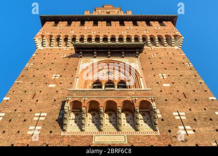 Sforza Castle close-up, Milan, Italy. It is a famous landmark of the city. Bottom view of main tower in summer. Renaissance architecture in the Milan - Stock Photo