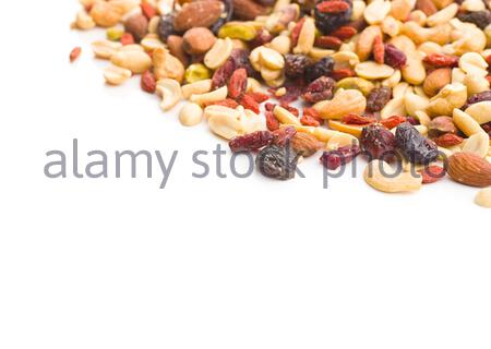 Mix of various nuts and raisins isolated on white background. - Stock Photo