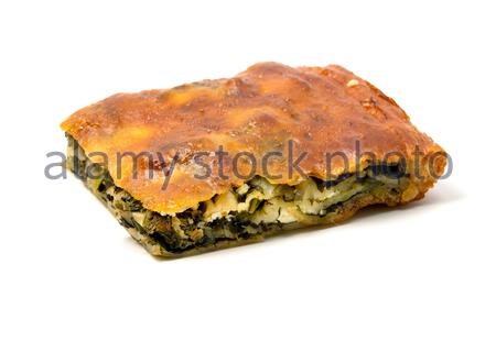 Typical Borek with a spinach and cheese filling on a white background - Stock Photo
