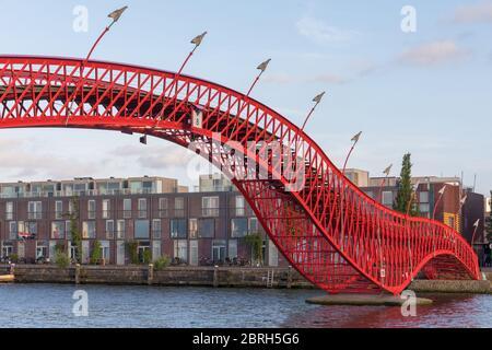 Red Pyton Bridge Landmark in Amsterdam Netherlands Stock Photo
