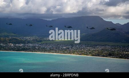 U.S. Marines with Marine Aircraft Group 24, conducted an integrated training mission along the shores of Oahu from Marine Corps Air Station Kaneohe Bay, Marine Corps Base Hawaii, May 19, 2020. Utilizing three separate flying platforms, MAG-24 successfully launched seven CH-53E Super Stallions, seven MV-22B Ospreys, and two UH-1Y Venoms while hitting critical training objectives to produce maximum readiness. (U.S. Marine Corps photo by Cpl. Eric Tso) - Stock Photo