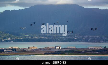 U.S. Marines with Marine Aircraft Group 24, conducted integrated training mission along the shores of Oahu from Marine Corps Air Station Kaneohe Bay, Marine Corps Base Hawaii, May 19, 2020. Utilizing three separate flying platforms, MAG-24 successfully launched seven CH-53E Super Stallions, seven MV-22B Ospreys, and two UH-1Y Venoms while hitting critical training objectives to produce maximum readiness. (U.S. Marine Corps photo by Cpl. Eric Tso) - Stock Photo