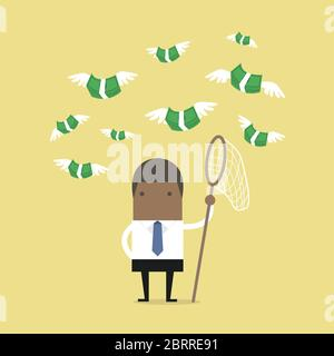 African businessman trying to catch money fly. - Stock Photo
