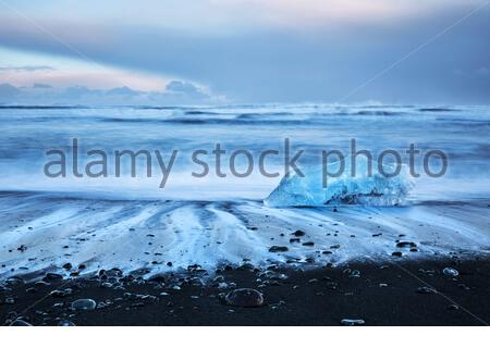Iceland, famous black beach with icebergs also known as Diamond beach, Jokulsarlon glacier lagoon, beautiful evening landscape in Vatnajokull National - Stock Photo