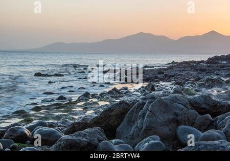 Misty sunset at beach in Puerto Del Carmen Lanzarote, Canary Islands