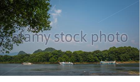 Guilin, China -  August 2019 : Small local passenger boats sailing on the magnificent Li river from Guilin to Yangshuo - Stock Photo