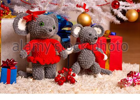 Two funny plush mice under the Christmas tree - Stock Photo