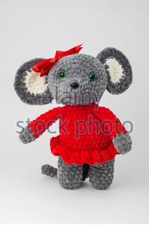Plush mouse with a red bow on its head - Stock Photo