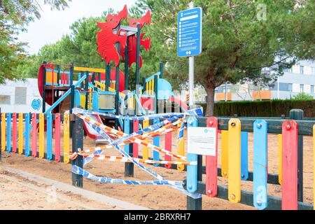 Huelva, Spain - May 5, 2020: Empty and closed children playground at sunset due to the alarm state and quarantine in Spain for the epidemic period of