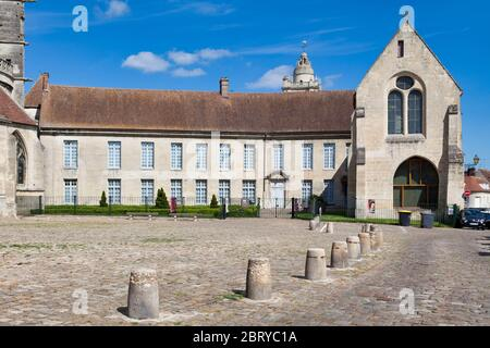 Senlis, France - May 19 2020: Parvise of the cathedral Notre-Dame de Senlis with the old episcopal palace. An Episcopal Palace (also known as a Bishop