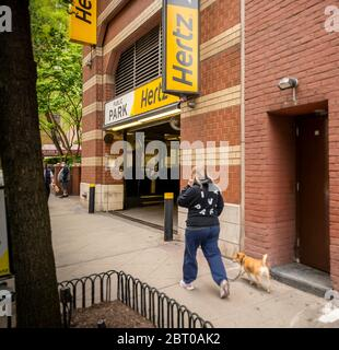 A garage renting Hertz vehicles in New York on Tuesday, May 19, 2020. Hertz is reported to be preparing for a possible bankruptcy of its U.S. division.(© Richard B. Levine) - Stock Photo