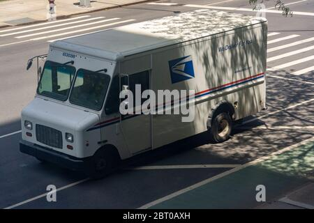 A USPS vehicle in Chelsea in New York on Saturday, May 16, 2020. (© Richard B. Levine) - Stock Photo