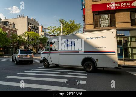 A USPS vehicle in Chelsea in New York on Friday, May 15, 2020. (© Richard B. Levine) - Stock Photo
