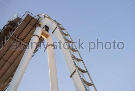 detail of curved rollercoaster track at sunset . - Stock Photo