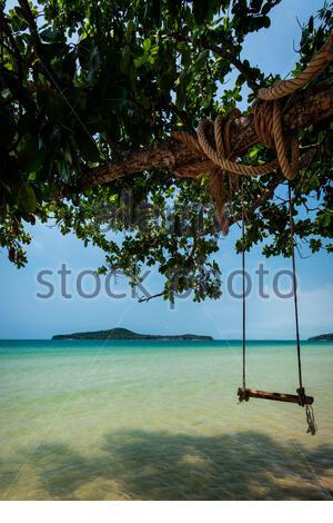 rustic rope swing in Long Beach on Koh Ta Kiev paradise island near Sihanoukville Cambodia - Stock Photo