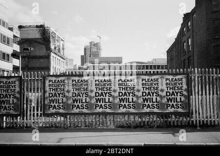 Posters on a fence in Shoreditch, East London UK, during the coronavirus lockdown, May 2020 - Stock Photo