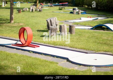 mini golf place, grass around some play ares, sunny day - Stock Photo