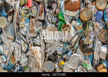 crushed metal consumer recyclables a the dump - Stock Photo